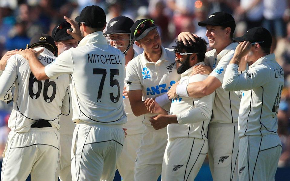 New Zealand's Ajaz Patel (3R) celebrates after New Zealand's Tom Blundell (L) caught England's Joe Root off his bowling on the third day of the second Test cricket match between England and New Zealand at Edgbaston Cricket - AFP
