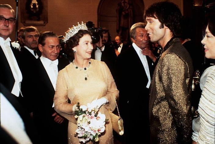 <p>Queen Elizabeth looked stunned meeting singer Cliff Richard and after seeing his gilded blazer, I can see why. It's bold, sure. But dare I say that it also somehow works?</p>