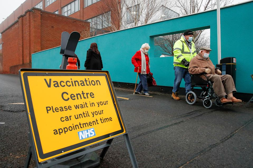 People queue outside a vaccination centre for the coronavirus disease (COVID-19), outside IMEX House in Hemel Hempstead, Britain, January 8, 2021. REUTERS/Paul Childs
