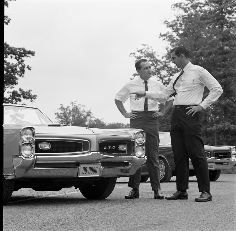 UNITED STATES - JULY 15: 1966 1966 Pontiac GTO. Car Craft Editorial Director Dick Day (left) speaks with Pontiac General Manager John Delorean about the 1966 GTO styling. (Photo by Bob D'Olivo/The Enthusiast Network via Getty Images/Getty Images)