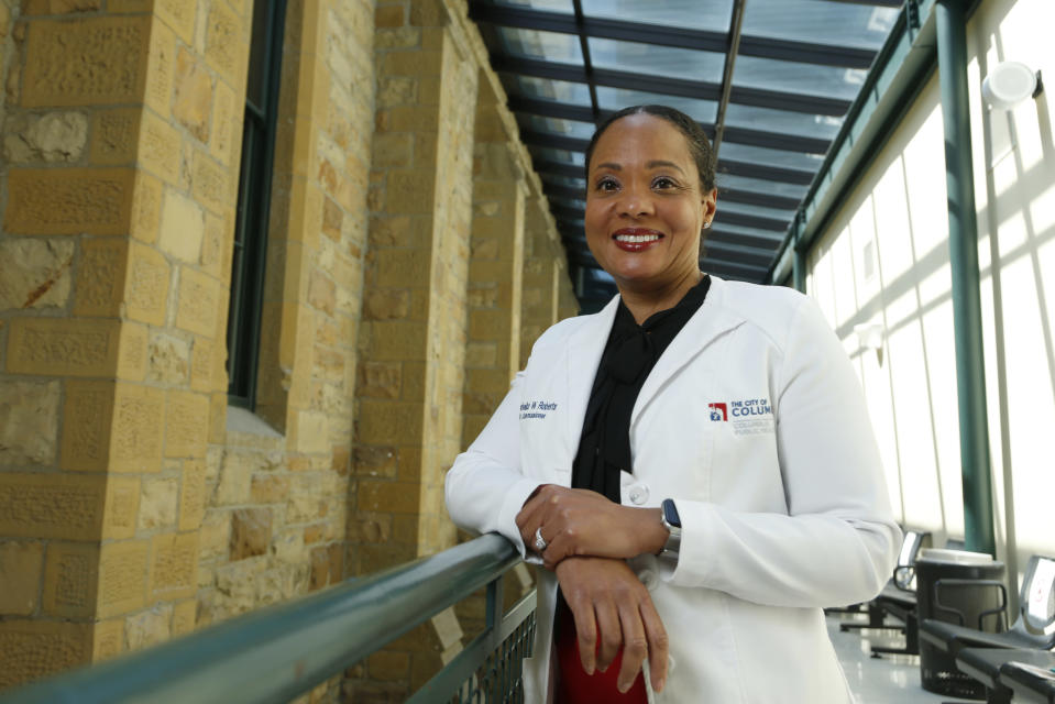 """Dr. Mysheika W. Roberts, the health commissioner for Columbus Public Health, poses for a portrait in Columbus, Ohio, on Wednesday, April 14, 2021. Public health officials who have juggled bare-bones budgets for years are happy to have the additional money prompted by the COVID-19 pandemic. Yet they worry it will soon dry up as the pandemic recedes, continuing a boom-bust funding cycle that has plagued the U.S. public health system for decades. If budgets are slashed again, they warn, that could leave the nation where it was before covid: unprepared for a health crisis. """"We need funds that we can depend on year after year,"""" says Roberts. (AP Photo/Paul Vernon)"""