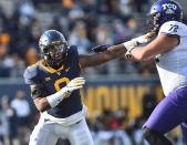 West Virginia defensive lineman Jeffery Pooler Jr. (9) works around TCU offensive tackle T.J. Storment (72) during the second half of an NCAA college football game on Saturday, Nov. 14, 2020, in Morgantown, W.Va. (William Wotring/The Dominion-Post via AP)