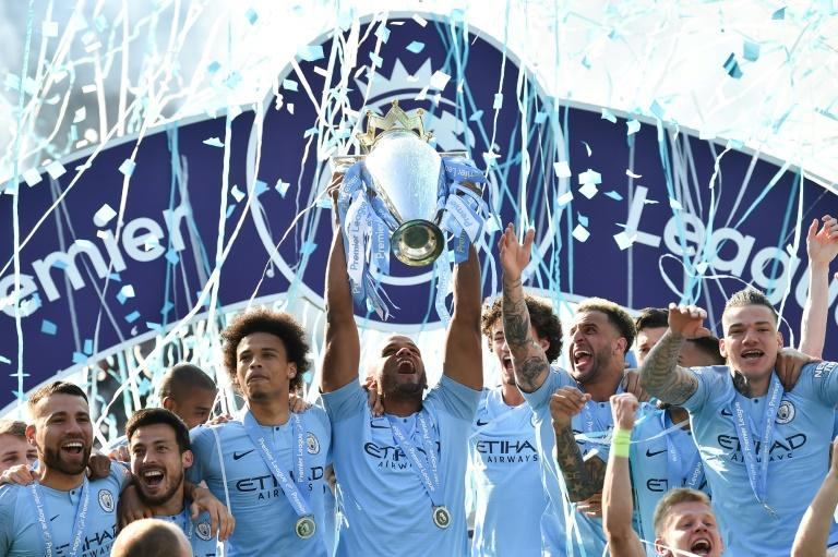 Manchester City have become serial winners thanks to Abu Dhabi investment (AFP/Glyn KIRK)