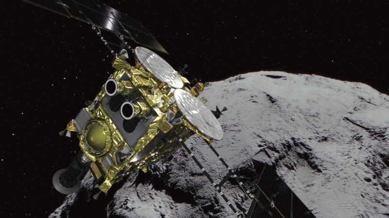 This computer graphics image provided by the Japan Aerospace Exploration Agency (JAXA) shows an asteroid and asteroid explorer Hayabusa2. The Japanese space explorer that will try to blow a crater in an asteroid and bring back samples from inside is nearing its destination after a 3 1/2 -year journey. The unmanned Hayabusa2 has arrived at the asteroid Wednesday, June 27, 2018, about 280 million kilometers (170 million miles) from Earth.(JAXA via AP)