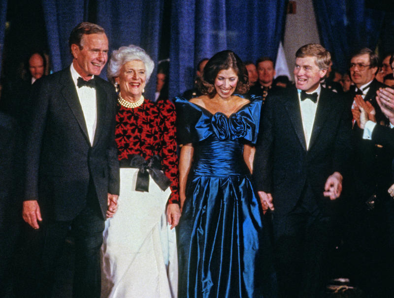 US President-Elect George HW Bush, Barbara Bush, Marilyn Quayle, and Vice President-Elect Dan Quayle attend the Black Tie and Boots Inaugural Gala at the Washington Convention Center, Washington DC, January 18, 1989.