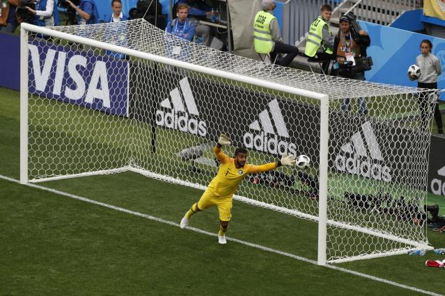 <p>Russia's Alexander Golovin scores his side's fifth goal as Saudi Arabia goalkeeper Abdullah Almuaiouf makes an attempt to stop the ball during the group A match between Russia and Saudi Arabia which opens the 2018 soccer World Cup at the Luzhniki stadium in Moscow, Russia, Thursday, June 14, 2018. Russia won 5-0. (AP Photo/Darko Bandic) </p>