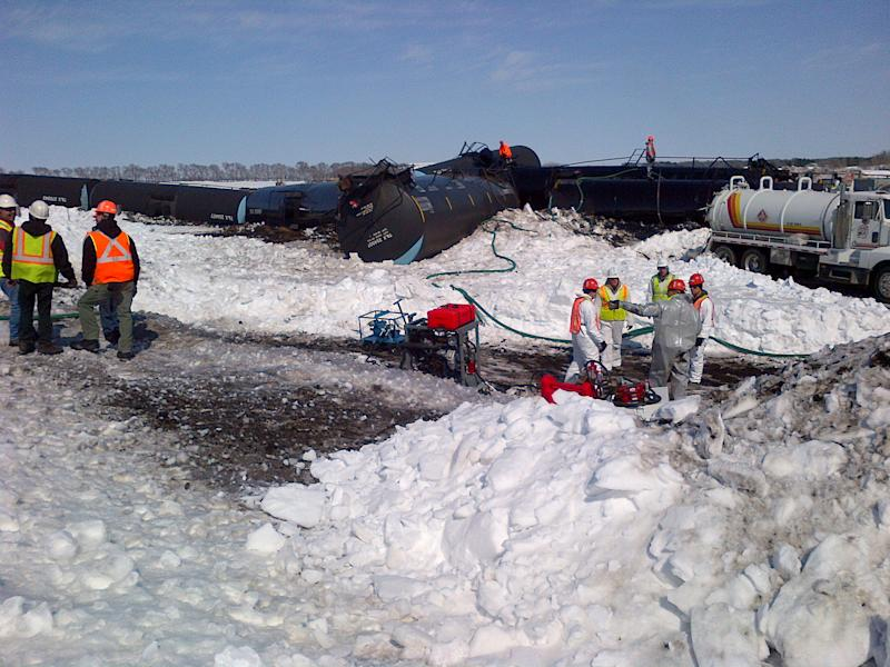 RE-TRANS FOR WITH HIGHER RESOLUTION - This photo from the Minnesota Pollution Control Agency shows crews at the scene of a Canadian Pacific train derailment that spilled thousands of gallons of crude oil near Parkers Prairie in western Minnesota on Wednesday, March 27, 2013. (AP Photo/Minnesota Pollution Control Agency)