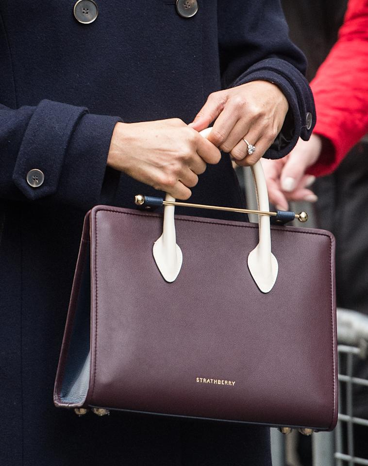 <p>The tri-tone leather tote is from Edinburgh-based brand Strathberry – but only available from Sak's in NYC. The store sent Markle the bag a few weeks ago. According to The Telegraph, the bag sold out within minutes of Markle wearing it. [Photo: Getty] </p>