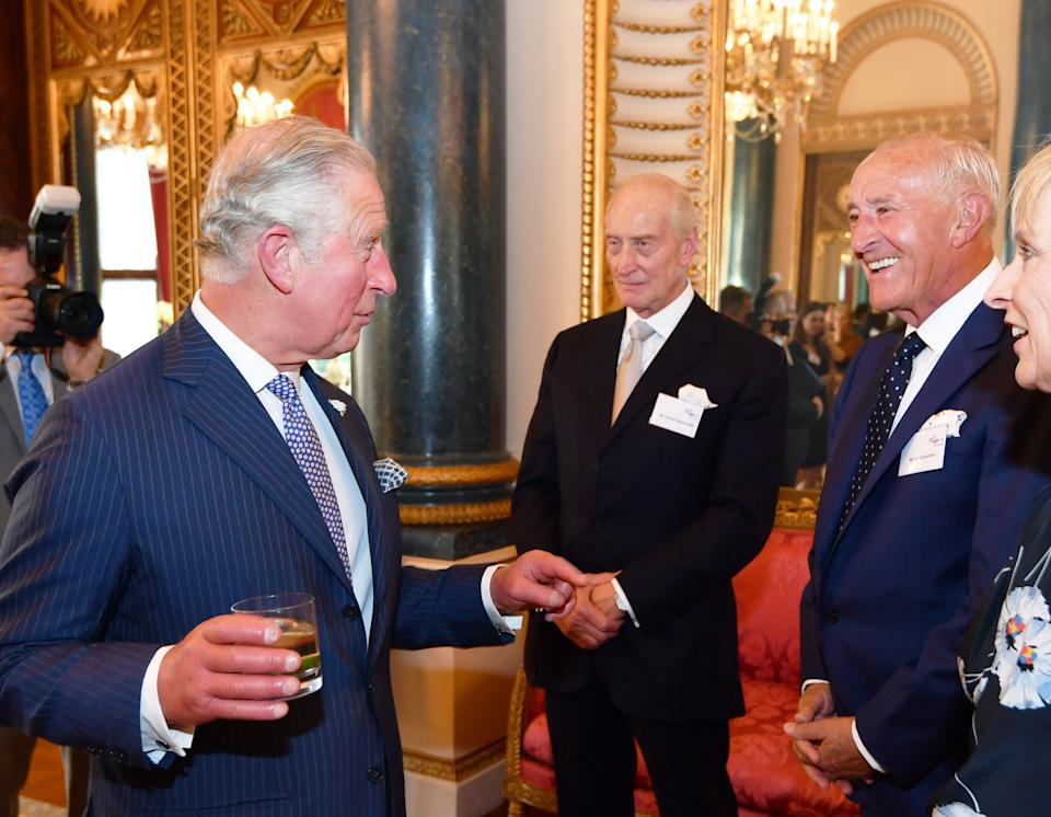 LONDON, ENGLAND - JUNE 6:   Prince Charles, Prince of Wales speaks to Charles Dance and Len Goodman and during a reception for Age UK at Buckingham Palace on June 6, 2018 in London, England. (Photo by John Stillwell -WPA Pool/Getty Images)