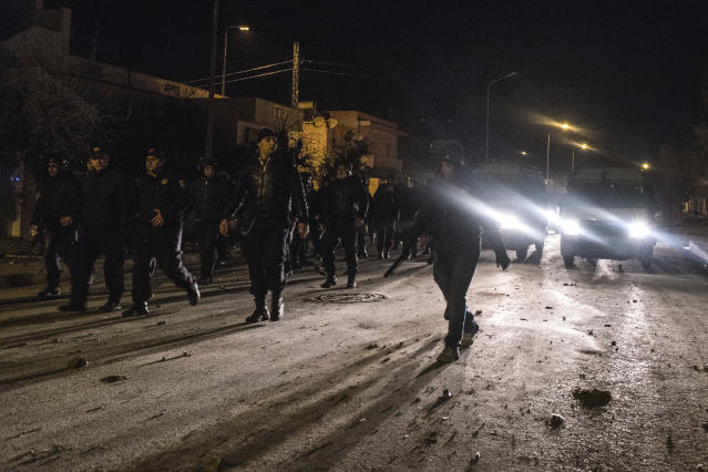 <p>Riot police patrol in the streets of Tebourba, south of the Tunisian capital, Tunis, after clashes with demonstrators, Jan. 9, 2018. (Photo: Amine Landoulsi/AP) </p>