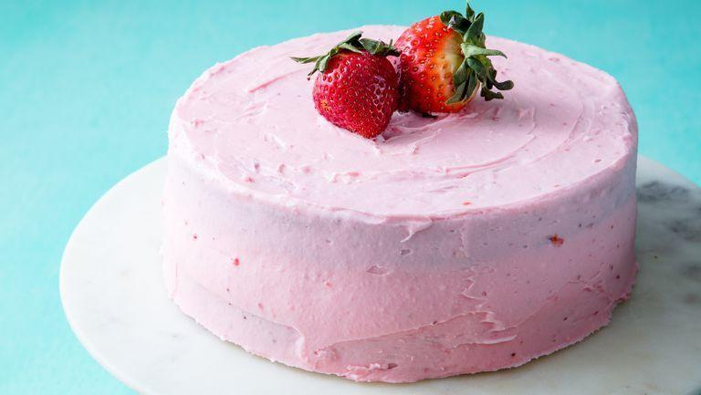 """<p>Strawberries not only appear in the creamy frosting, but tthe cake is also infused with strawberry compote. </p><p><em>Get the recipe from <a href=""""https://www.delish.com/cooking/recipe-ideas/a19624120/homemade-strawberry-cake-recipe/"""" rel=""""nofollow noopener"""" target=""""_blank"""" data-ylk=""""slk:Delish"""" class=""""link rapid-noclick-resp"""">Delish</a>.</em></p>"""