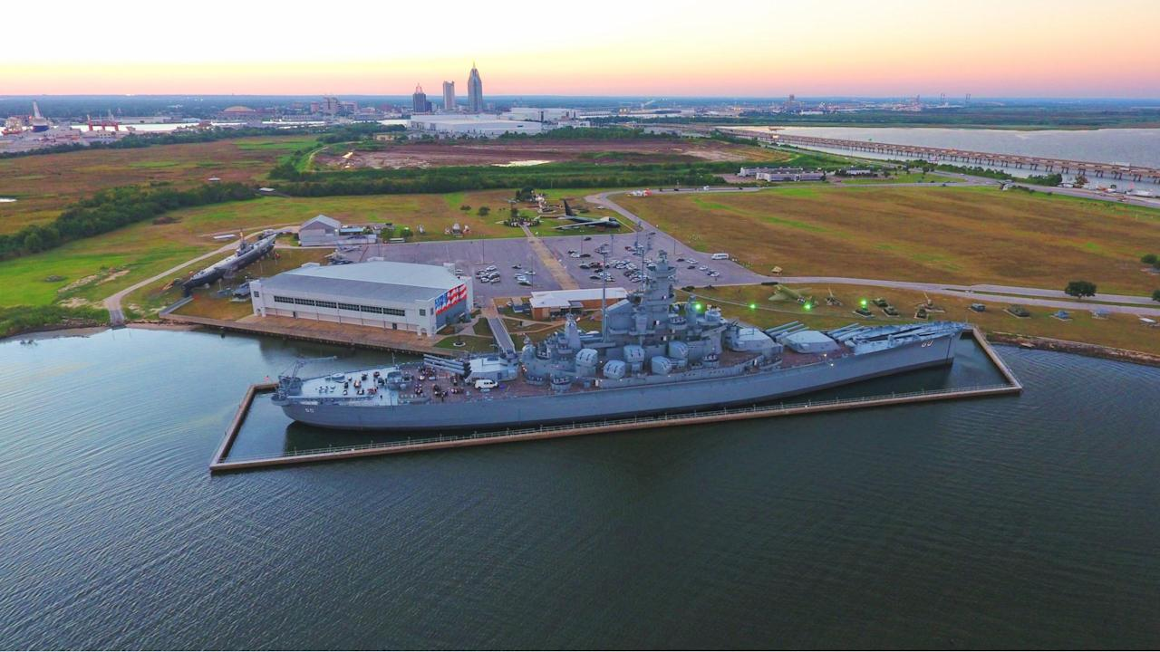 """<p>The USS Alabama, aka Mighty A, served a noble career in World War II and is now permanently moored in Mobile Bay, serving as a museum ship in her namesake state. The Alabama measures half as long as the Empire State Building is tall, and has now hosted millions of visitors as part of Mobile's Battleship Memorial Park. You may have seen her in the 2016 Nicolas Cage film """"USS Indianapolis: Men of Courage,"""" or in the many photos taken by Alabama visitors.</p>"""