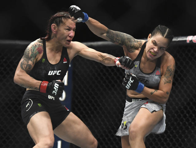 Amanda Nunues, right, throws a punch to Cris Cyborg during the first round of a featherweight title mixed martial arts bout at UFC 232, Saturday, Dec. 29, 2018, in Inglewood, Calif. (AP Photo/Kyusung Gong)