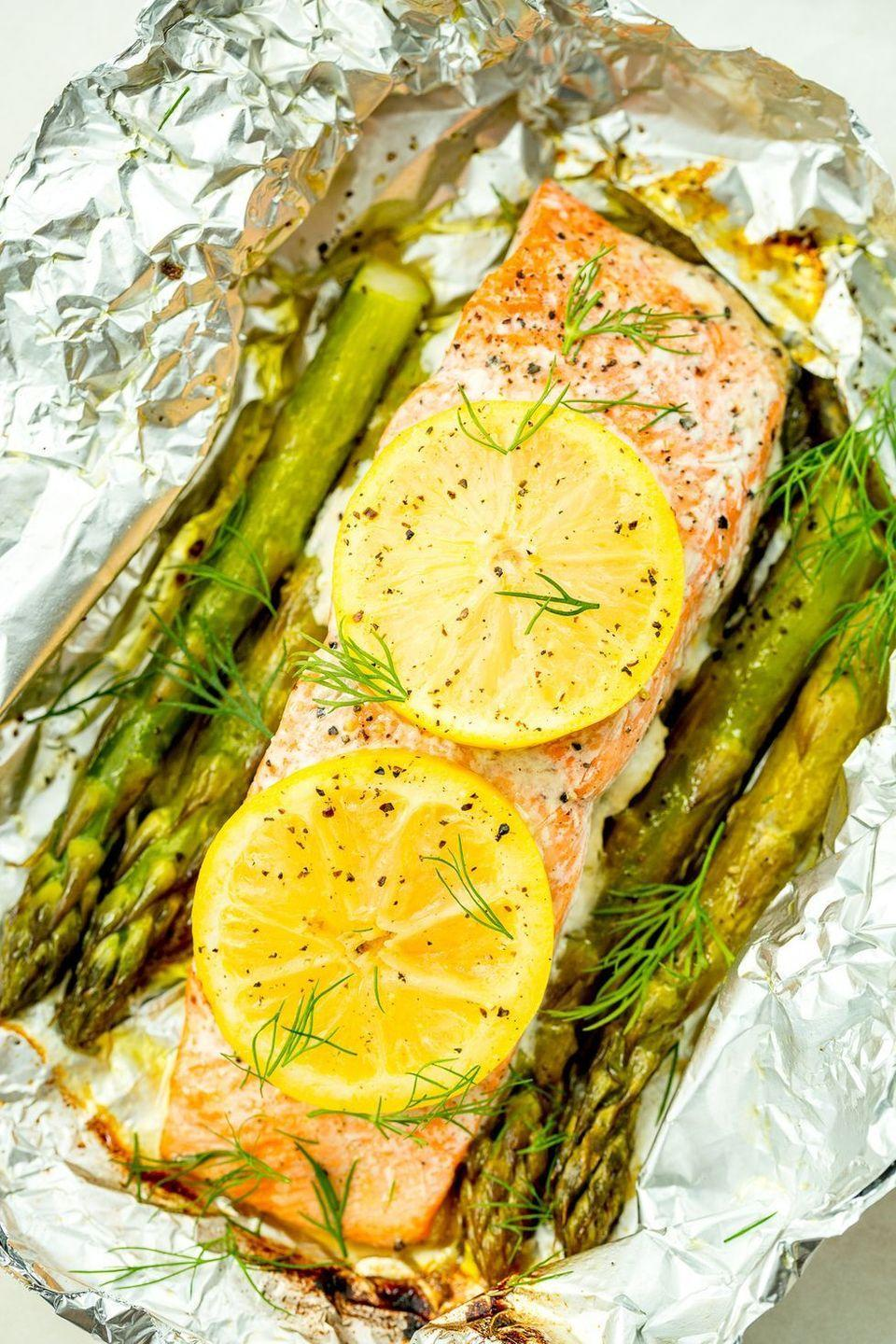 """<p>This grilled <a href=""""https://www.delish.com/uk/salmon-recipes/"""" rel=""""nofollow noopener"""" target=""""_blank"""" data-ylk=""""slk:salmon recipe"""" class=""""link rapid-noclick-resp"""">salmon recipe</a> is extremely easy and incredibly quick—the whole thing comes together in just 25 minutes.</p><p>Get the <a href=""""https://www.delish.com/uk/cooking/recipes/a29205113/foil-pack-grilled-salmon-with-lemony-asparagus-recipe/"""" rel=""""nofollow noopener"""" target=""""_blank"""" data-ylk=""""slk:Foil Pack Grilled Salmon with Lemony Asparagus"""" class=""""link rapid-noclick-resp"""">Foil Pack Grilled Salmon with Lemony Asparagus</a> recipe.</p>"""
