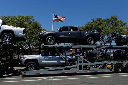 FILE PHOTO: Toyota trucks are shown on a car carrier for delivery after arriving in the United States in National City, California, U.S. June 27, 2018.   REUTERS/Mike Blake