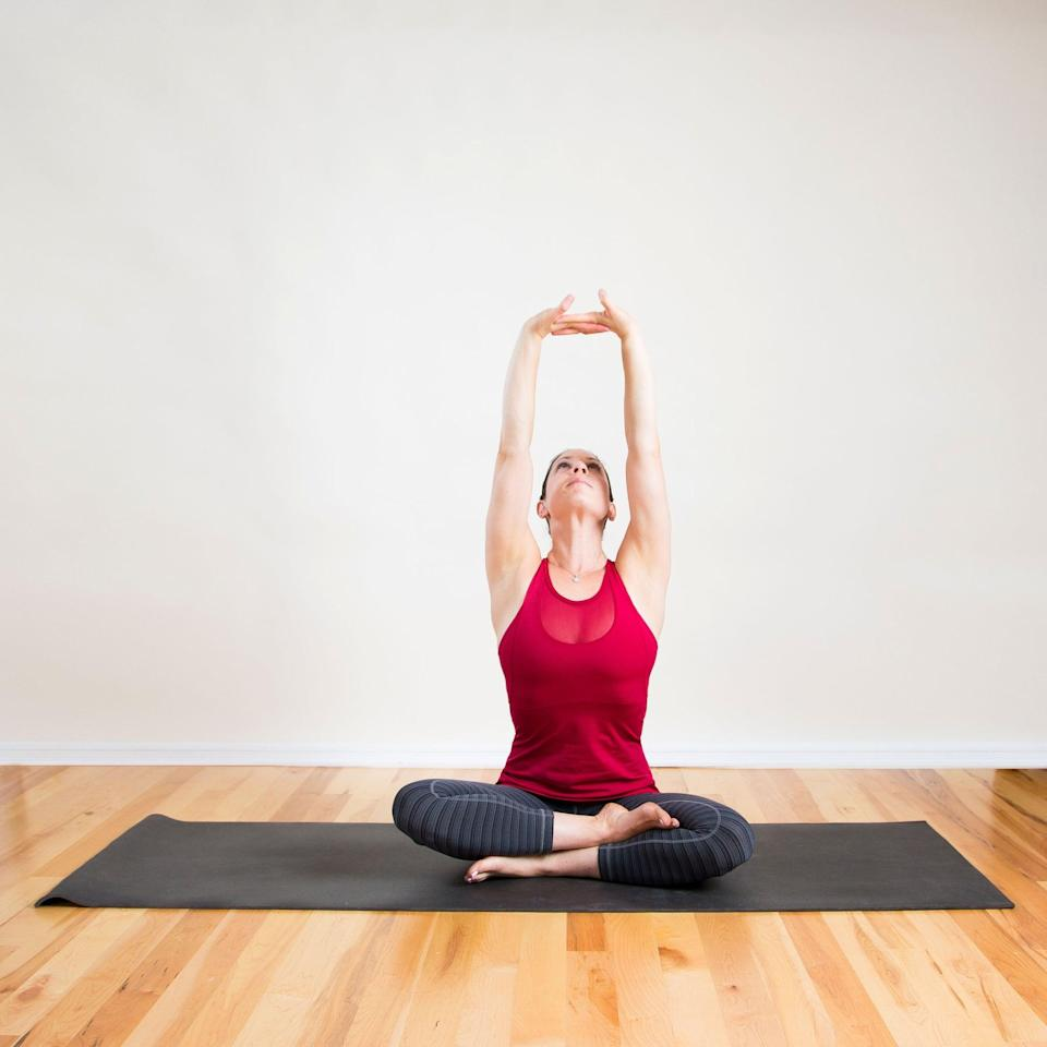 <ul> <li>Sit in a comfortable cross-legged seated position. </li> <li>Interlace your hands as you raise your arms overhead, pressing your palms toward the sky. </li> <li>Gaze at your hands, breathing deeply into the chest for 30 seconds. </li> </ul>