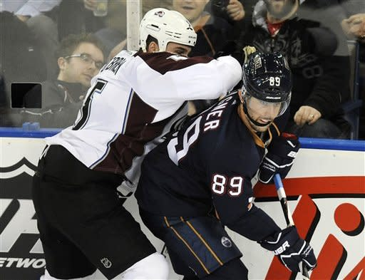 Colorado Avalanche's Shane O'Brien, left, hits Edmonton Oilers' Sam Gagner during the second period of an NHL hockey game, Tuesday, Jan. 31, 2012, in Edmonton, Alberta. (AP Photo/The Canadian Press, John Ulan)