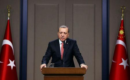 Turkish President Erdogan speaks during a news conference in Ankara