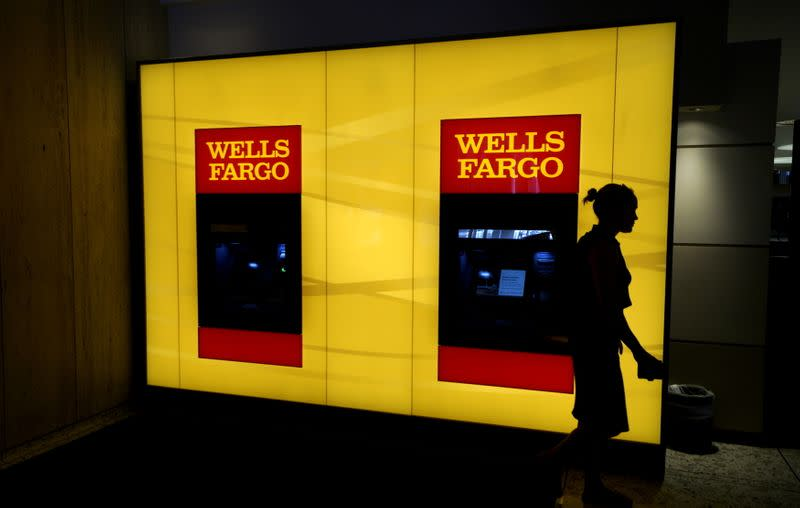 FILE PHOTO: A customer leaves an ATM at the Wells Fargo & Co. bank in downtown Denver