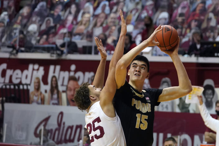 Purdue's Zach Edey (15) shoots over Indiana's Race Thompson (25) during the first half of an NCAA college basketball game, Thursday, Jan. 14, 2021, in Bloomington Ind. (AP Photo/Darron Cummings)
