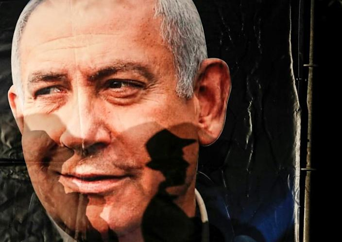 For or against Netanyahu, Israeli voters are to get a new chance to give their verdict on the veteran right-wing incumbent in March after two elections this year ended in deadlock (AFP Photo/AHMAD GHARABLI)