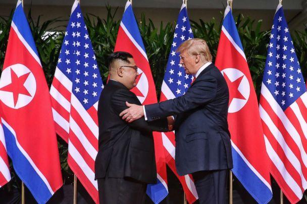PHOTO: North Korean leader Kim Jong-un shakes hands with President Donald Trump during their historic U.S.-DPRK summit at the Capella Hotel on Sentosa island on June 12, 2018 in Singapore. (Getty Images, FILE)
