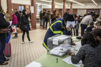 <p>Qualified voters cast a ballot for the Catalan regional election at an elementary school in Barcelona, Spain, Dec. 21, 2017.<br>(Photograph by Jose Colon / MeMo for Yahoo News) </p>