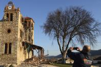 Damage is seen on a church after an earthquake in Mesochori village, central Greece, Wednesday, March 3, 2021. An earthquake with a preliminary magnitude of at least 6.0 struck central Greece Wednesday and was also felt in neighboring Albania and North Macedonia, and as far as Kosovo and Montenegro. (AP Photo/Vaggelis Kousioras)