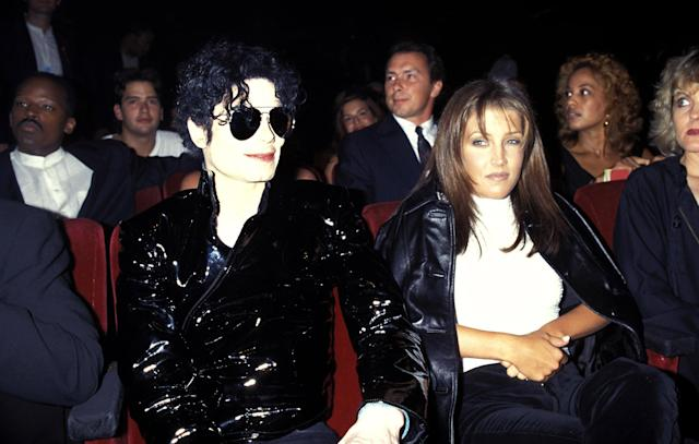 <p>They divorced in 1996, but Lisa Marie told Oprah that they spent four years following their divorce together, on and off, trying to reconcile. (Photo: KMazur/WireImage) </p>