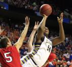 Marquette forward Davante Gardner (54) goes up for a shot as Davidson guard JP Kuhlman (5) defends during the first half of a second-round game in the NCAA college basketball tournament, Thursday, March 21, 2013, in Lexington, Ky. (AP Photo/James Crisp)