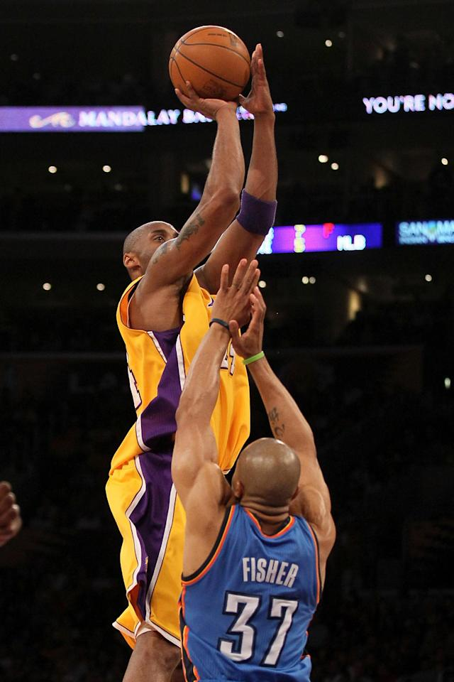 LOS ANGELES, CA - MAY 19: Kobe Bryant #24 of the Los Angeles Lakers shoots over Derek Fisher #37 of the Oklahoma City Thunder in the first quarter in Game Four of the Western Conference Semifinals in the 2012 NBA Playoffs on May 19 at Staples Center in Los Angeles, California. NOTE TO USER: User expressly acknowledges and agrees that, by downloading and or using this photograph, User is consenting to the terms and conditions of the Getty Images License Agreement. (Photo by Stephen Dunn/Getty Images)