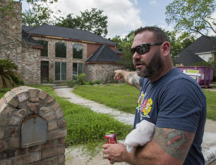 Waller County Sheriff's Office Deputy Wes Manion talks about his encounter with a tiger the night before on the 1100 block of Ivy Wall Drive, Monday, May 10, 2021, in Houston. Manion, who was off-duty at the time, arrived shortly after seeing posts by neighbors. (Godofredo A. Vásquez/Houston Chronicle via AP)