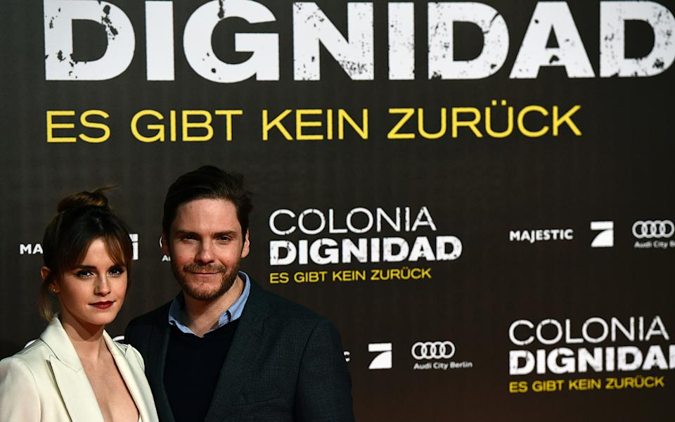 Emma Watson German actor Daniel Bruehl pose in front of a poster. Source: Getty Images