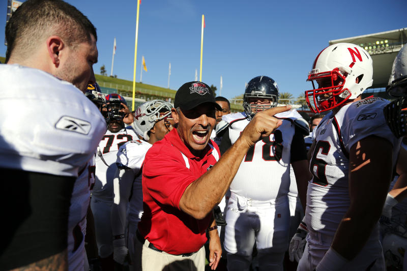 FILE - In this Jan. 19, 2013, file photo, American team head coach Herm Edwards talks with his team before the NFLPA Collegiate Bowl football game in Carson, Calif. The Rooney Rule is broken and must be fixed. That's how former NFL coaches Tony Dungy, Herm Edwards and Jim Caldwell feel after seeing openings for eight head coaches and seven general managers this offseason not go to any minority candidates. (AP Photo/AP Images for NFLPA, Ric Tapia, File)
