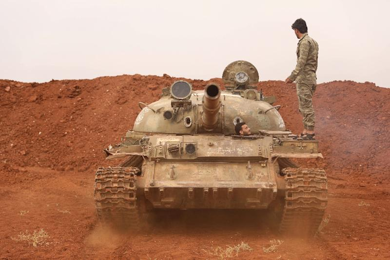 Syrian rebel-fighters from the National Liberation Front (NLF) in a tank on October 9, 2018 that had been withdrawn from a planned buffer zone around Idlib in northwestern Syria