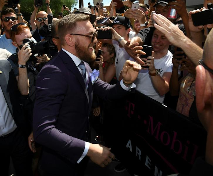 UFC lightweight champion Conor McGregor greets fans as he arrives at Toshiba Plaza on August 22, 2017 in Las Vegas, Nevada