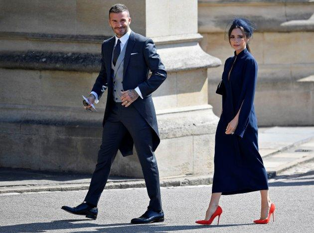 Former England footballer David Beckham (L) and fashion designer Victoria Beckham arrive for the wedding ceremony of Britain's Prince Harry, Duke of Sussex and US actress Meghan Markle at St George's Chapel, Windsor Castle, in Windsor, on May 19, 2018. (Photo by TOBY MELVILLE / POOL / AFP) (Photo credit should read TOBY MELVILLE/AFP/Getty Images)