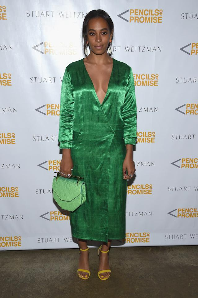 <p>For the evening, Solo was hard to be missed in a shiny green wrap-effect dress, yellow Stuart Weitzman sandals, and a lighter green M2malletier bag. <i>(Photo: Getty)</i></p>