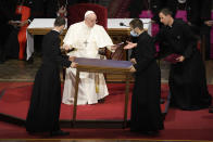 Priests carry a table in front of Pope Francis during a meeting with priests, religious men and women, seminarians and catechists, at the Cathedral of Saint Martin, in Bratislava, Slovakia, Monday, Sept. 13, 2021. Francis is on a four-day visit to Central Europe, in Hungary and Slovakia, in his first big international outing since undergoing intestinal surgery in July. (AP Photo/Gregorio Borgia)