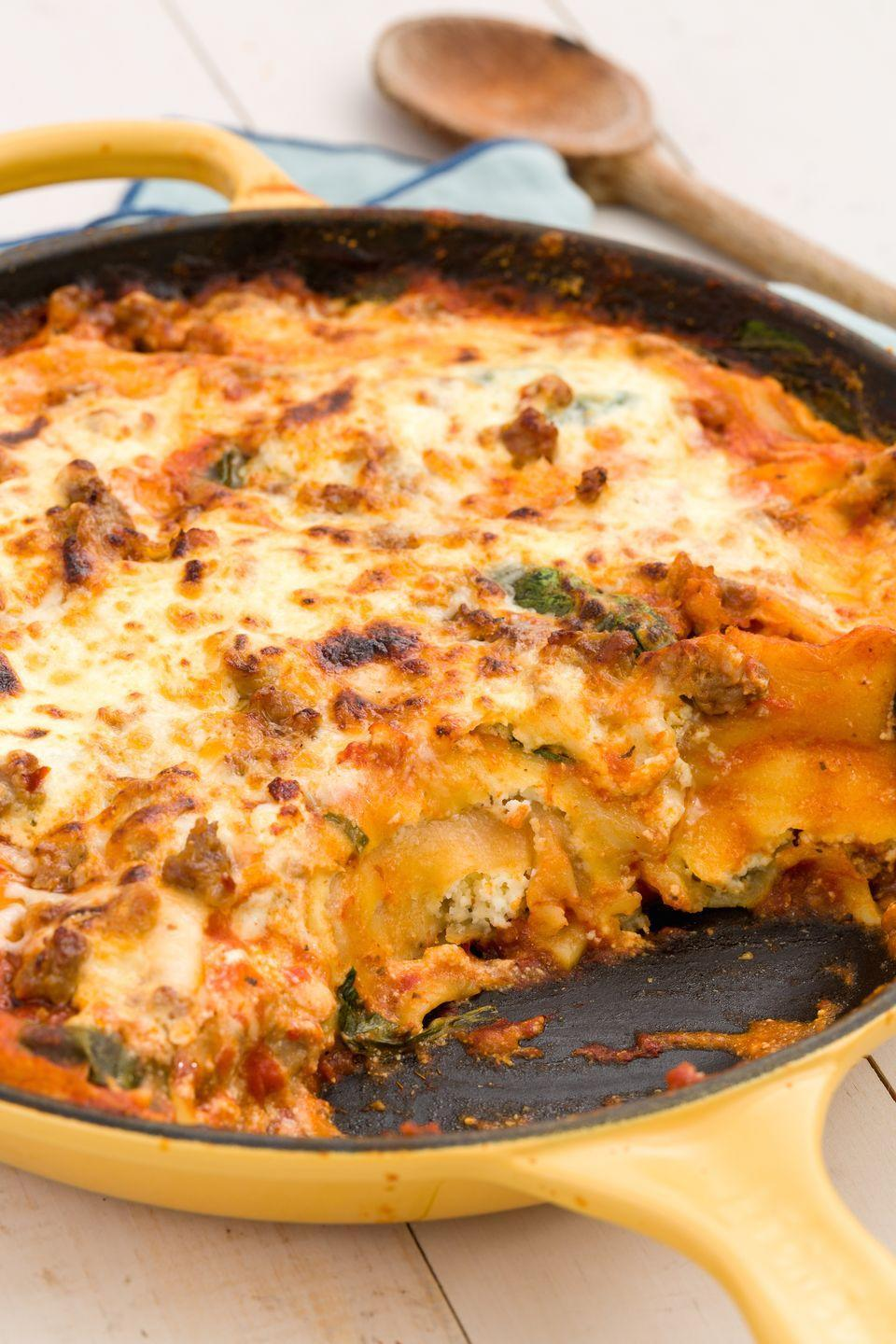 """<p>This cheater's lasagna is genius: You start with simmering marinara in a skillet, add ravioli and cooked sausage, and top it off with cheese for a melty one-pot meal.</p><p>Get the recipe from <a href=""""https://www.delish.com/cooking/recipe-ideas/recipes/a45604/skillet-ravioli-lasagna-with-spicy-italian-sausage-recipe/"""" rel=""""nofollow noopener"""" target=""""_blank"""" data-ylk=""""slk:Delish"""" class=""""link rapid-noclick-resp"""">Delish</a>.<br></p>"""