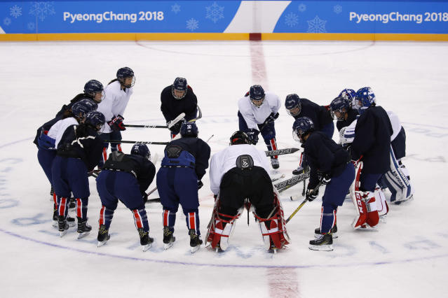 The joint Korean women's ice hockey players gather on the ice during a training session prior to the 2018 Winter Olympics. (AP Photo/Jae C. Hong)