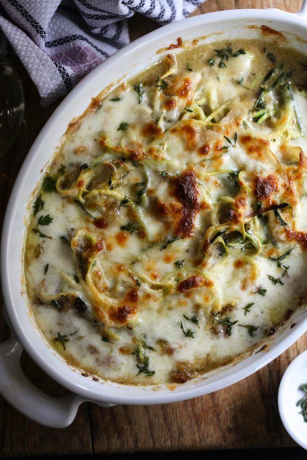 """<p>Send help because we're about to leap into this bowl of cheesy goodness. It's all the flavors of your favorite crock of soup melded into a perfect bowl of noodles.</p><p><a href=""""http://www.climbinggriermountain.com/2016/02/french-onion-zoodle-bake.html"""" rel=""""nofollow noopener"""" target=""""_blank"""" data-ylk=""""slk:Get the recipe from Climbing Grier Mountain »"""" class=""""link rapid-noclick-resp""""><em>Get the recipe from Climbing Grier Mountain »</em></a><br></p>"""
