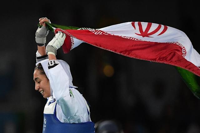 Iran's Kimia Alizadeh Zenoorin celebrates after winning against Sweden's Nikita Glasnovic in their women's taekwondo bronze medal bout at Rio 2016 Olympic Games (AFP Photo/Kirill Kudryavtsev)