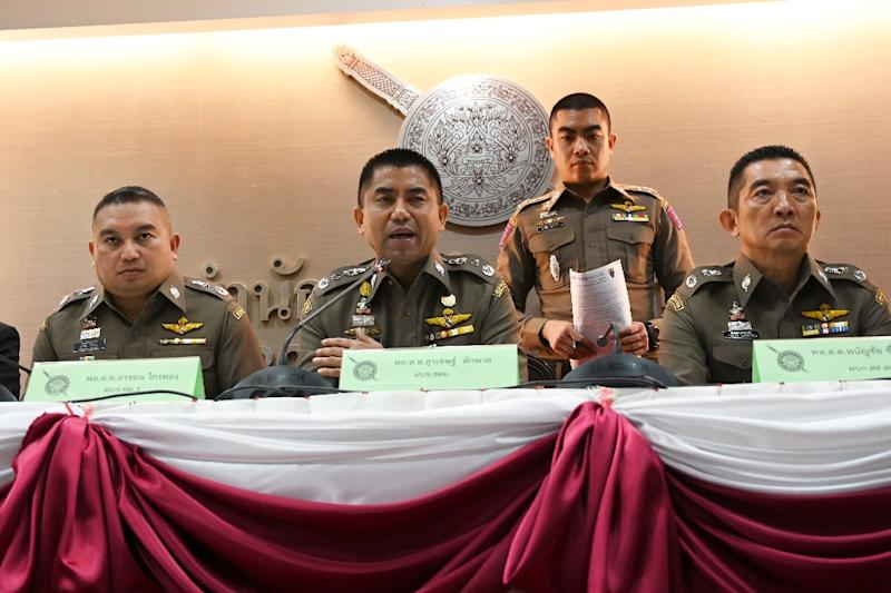 "Her father and brother arrived in Bangkok on Tuesday, but Qunun ""refused to see"" them, according to Thai immigration police chief Surachate Hakparn (C) (AFP Photo/Lillian SUWANRUMPHA)"