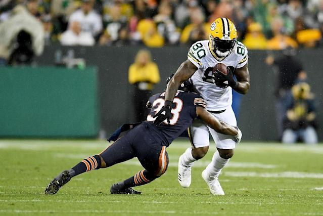 Adrian Amos #38 of the Chicago Bears tackles Martellus Bennett #80 of the Green Bay Packers on September 28, 2017 in Green Bay, Wisconsin. Bennett has now been let go by the Packers (AFP Photo/Stacy Revere)