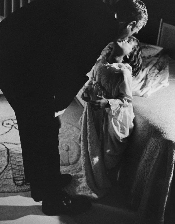 """Steve McQueen kisses his daughter Terry goodnight in 1963. <br><br><br><a href=""""http://life.time.com/news/fathers-day-special-life-with-famous-dads/#1"""">Click here</a> to see the full collection at LIFE.com…"""