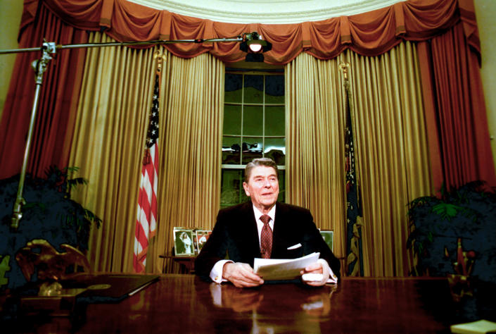 FILE - In this Jan. 11, 1989, file photo departing President Ronald Reagan sits in the Oval Office after he delivered his farewell address to the nation in the White House in Washington, on Wednesday, Jan. 11, 1989. (AP Photo/Ron Edmonds, File)
