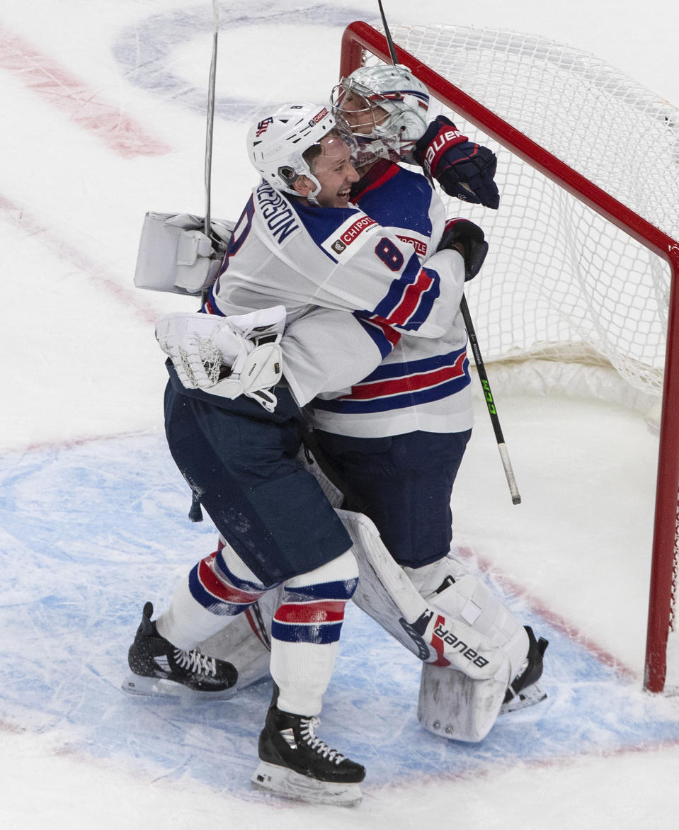 United States' Jake Sanderson (8) and goalie Spencer Knight (30) celebrate the team's win over Canada in the championship game in the IIHF World Junior Hockey Championship, Tuesday, Jan. 5, 2021, in Edmonton, Alberta. (Jason Franson/The Canadian Press via AP)