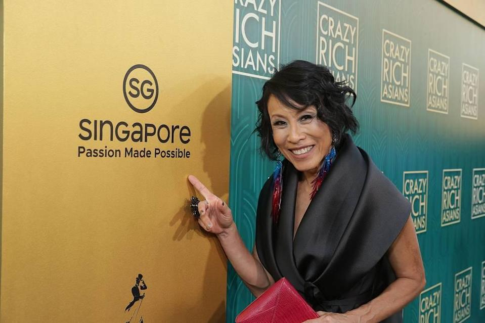 """Singaporean actress Tan Kheng Hua at the """"Crazy Rich Asians"""" premiere in Hollywood, with the Singapore Tourism Board's tagline logo. (PHOTO: Warner Bros)"""