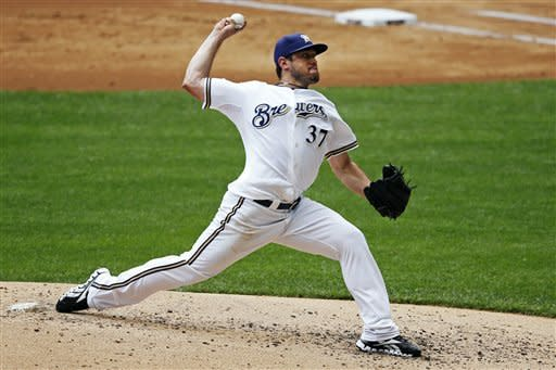 Milwaukee Brewers starting pitcher Mark Rogers throws against the Washington Nationals during the first inning of a baseball game, Sunday, July 29, 2012, in Milwaukee. (AP Photo/Tom Lynn)